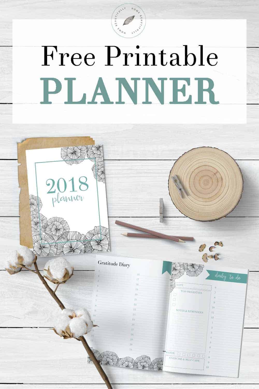 Free planner printable on a white wood background with cotton, a wood slice, and pencils