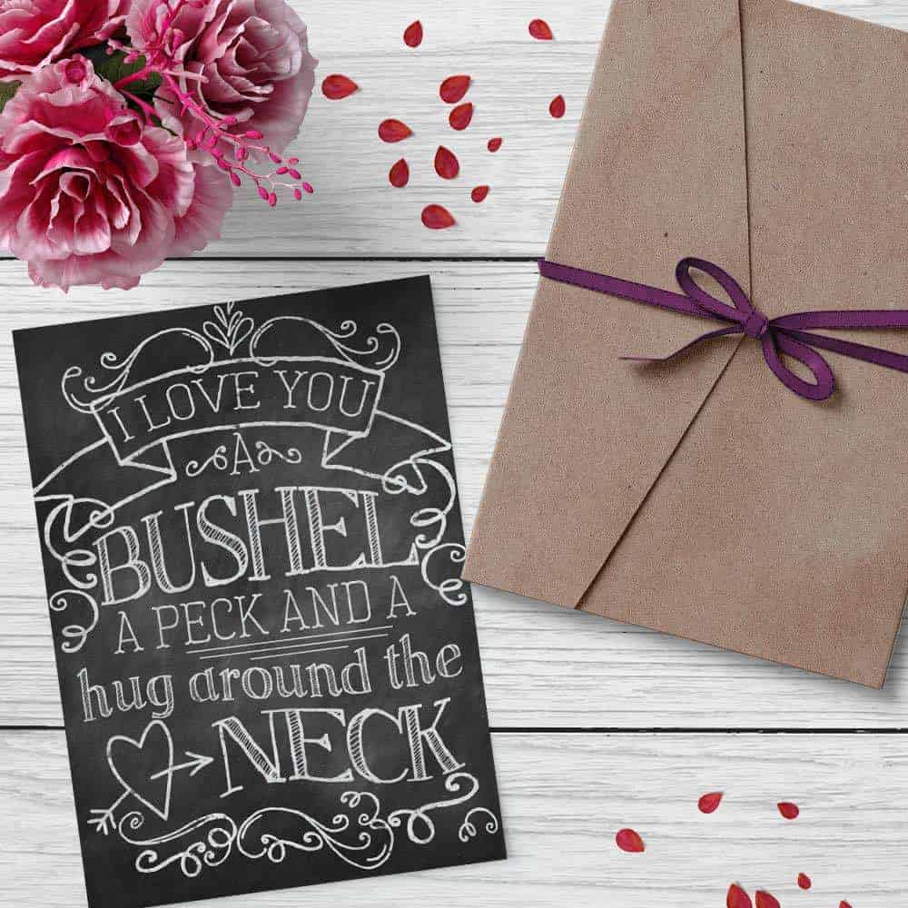 printable valentines card with rose petals on a wood background