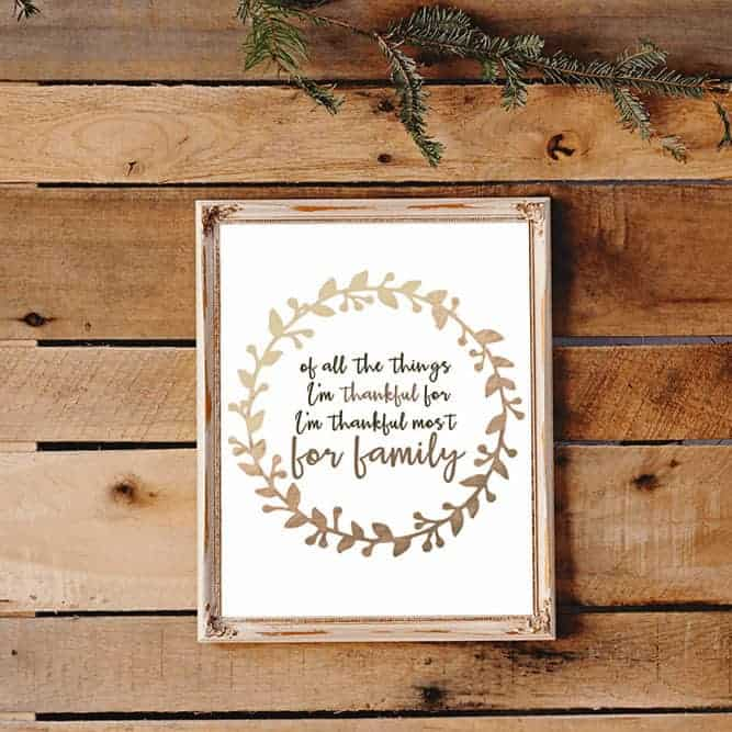 "free art print that says ""of all the things I'm thankful for, I'm thankful most for family"" in a wood frame on a wood background"