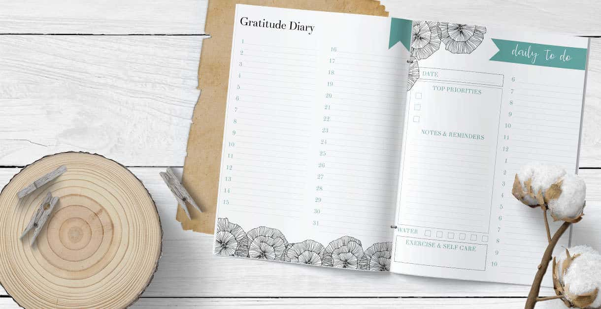 Gratitude and happiness diary printable and daily to do list printable on a white wood background