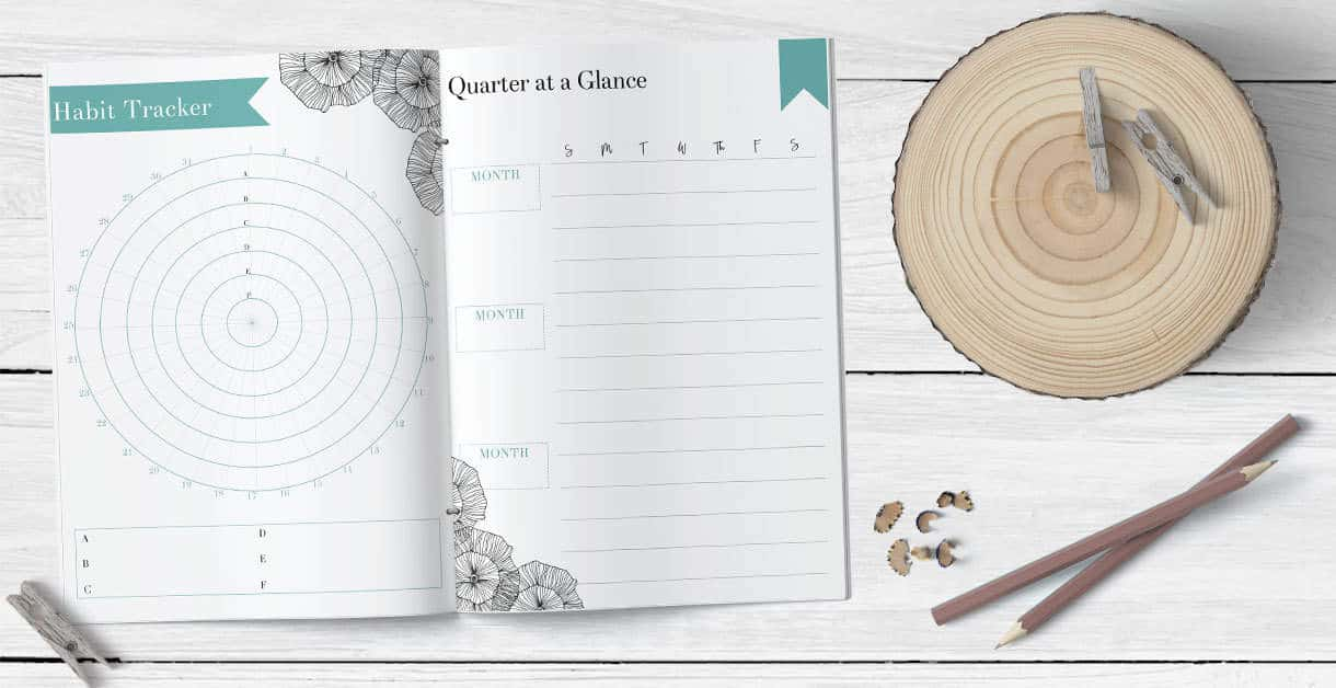 quarterly planner and habit tracker printable on a white wood background