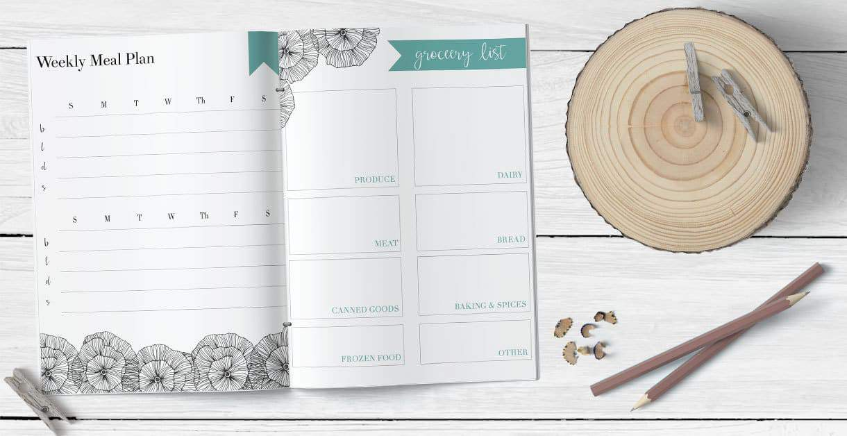 meal planning printable and grocery list printable on a white wood background